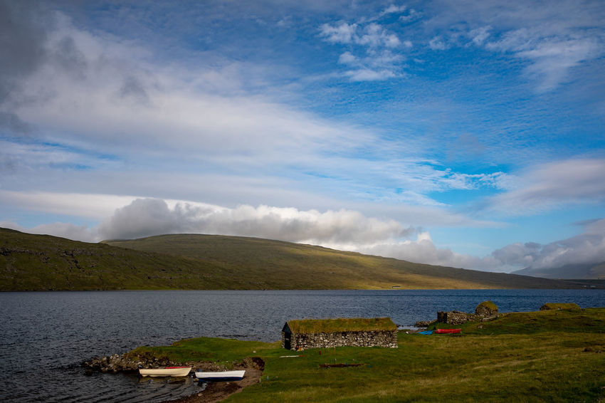 EyeEm Best Shots Tadaa Community Beach Beauty In Nature Boathouse Cloud - Sky Day Environment Faroe Islands Grass Lake Land Landscape Mountain Mountain Range Nature No People Non-urban Scene Outdoors Plant Scenics - Nature Sky Tranquil Scene Tranquility Water