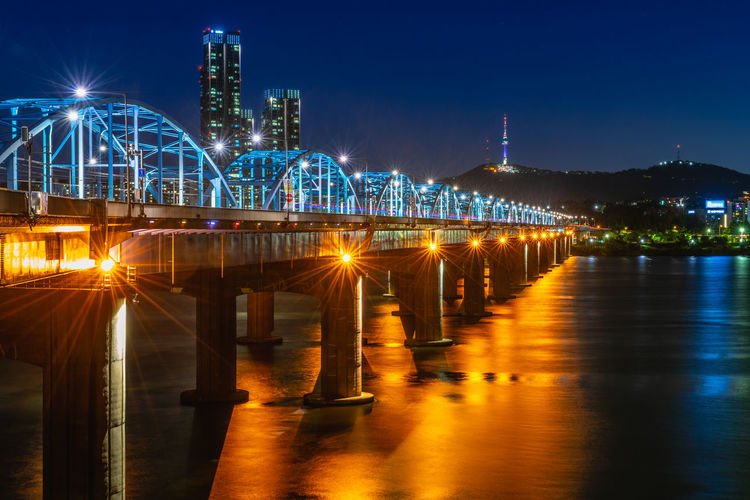 Horizon and Moon Bridge at Dongjak Bridge Han Bridge in Seoul, South Korea Architecture Bridge Bridge - Man Made Structure Building Building Exterior Built Structure City Cityscape Illuminated Nature Night No People Office Building Exterior Outdoors River Sky Skyscraper Travel Destinations Water Waterfront