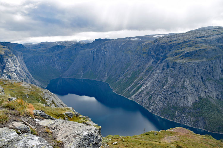 View along Trolltunga hike Norway Beauty In Nature Cloud - Sky Day Environment Flowing Water Formation Idyllic Lake Landscape Mountain Mountain Range Nature No People Non-urban Scene Outdoors Remote Rock Scenics - Nature Sky Tranquil Scene Tranquility Trolltunga Norway Hiking Volcanic Crater Water