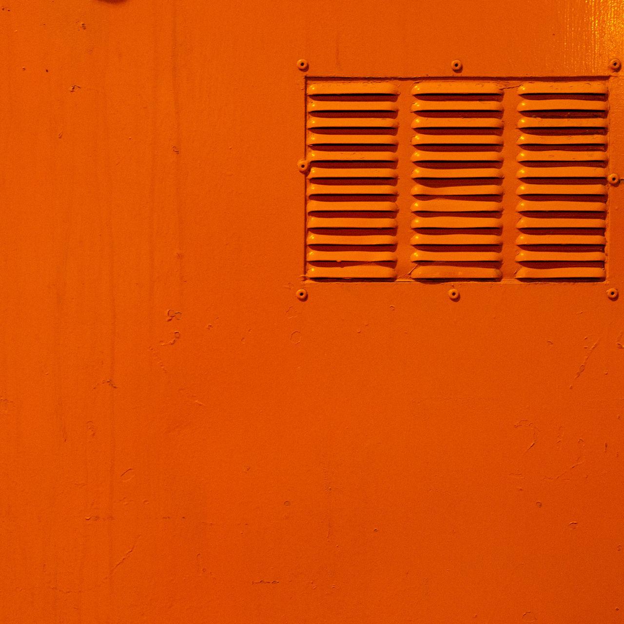 Full frame shot of orange metal locker