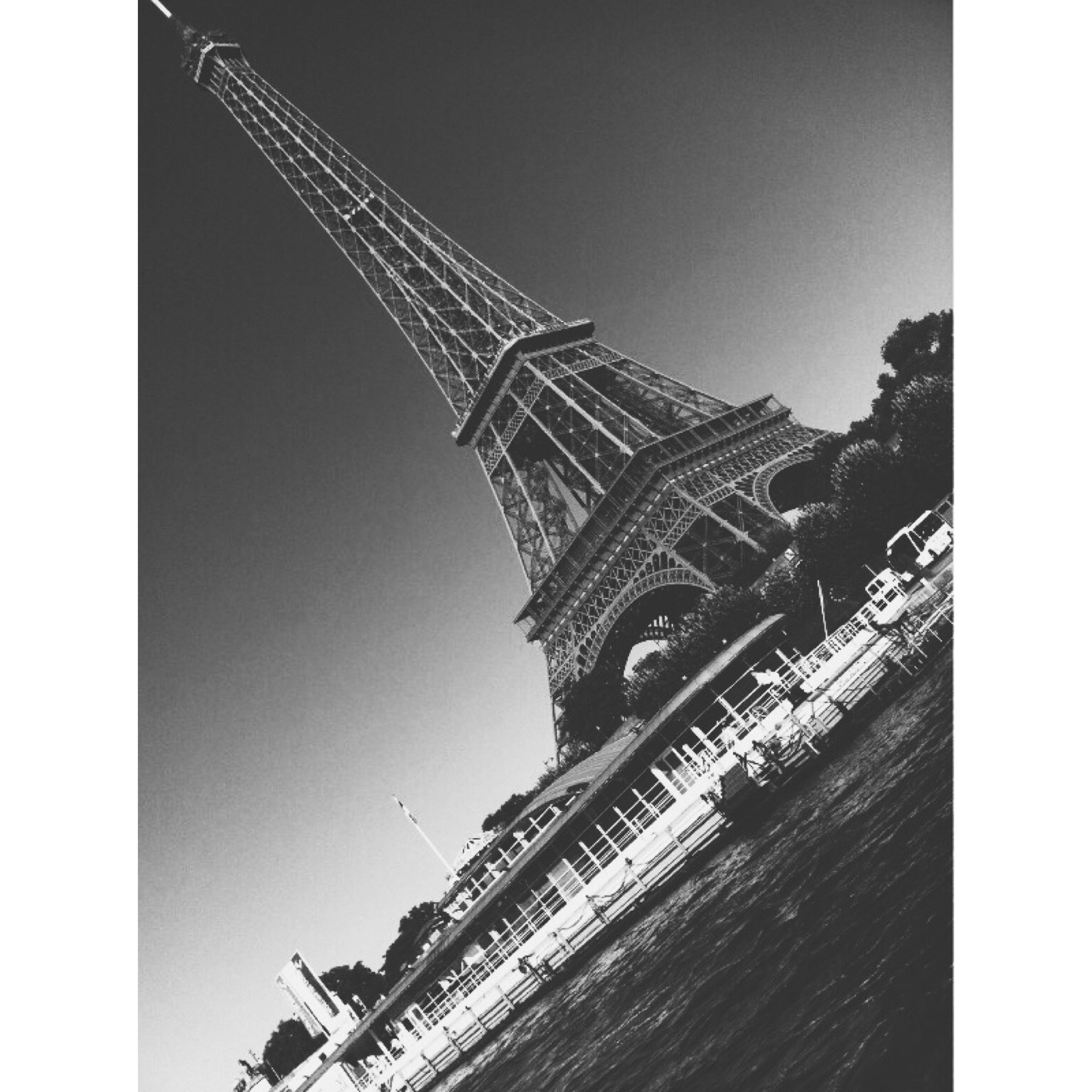 transfer print, built structure, architecture, low angle view, clear sky, auto post production filter, building exterior, copy space, international landmark, famous place, travel destinations, history, outdoors, travel, tourism, capital cities, sky, day, tower, eiffel tower