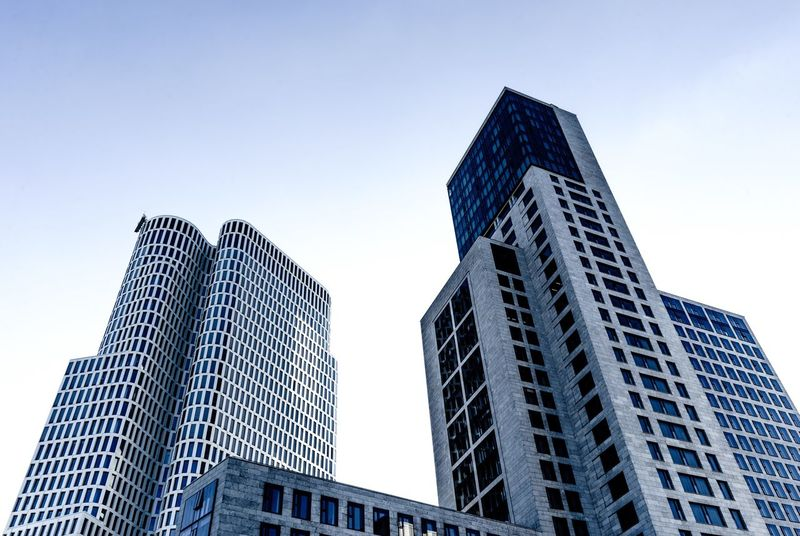 BERLIN Buildings. Skyscraper Low Angle View Architecture Modern Building Exterior City Development Built Structure Sky Day Downtown District City Life Outdoors Façade No People Clear Sky Business Urban Skyline Futuristic