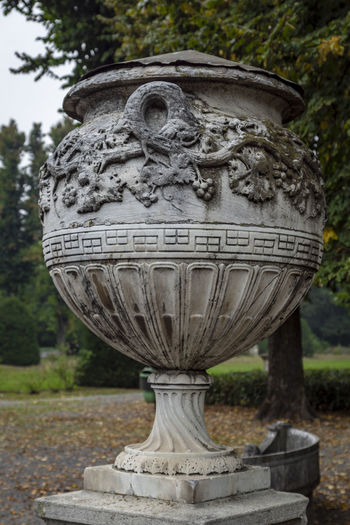 Day Art And Craft Sculpture No People Text Craft Close-up Focus On Foreground Outdoors Stone Material Decorative Urn Western Script Carving - Craft Product Park Memorial Creativity Communication Carving