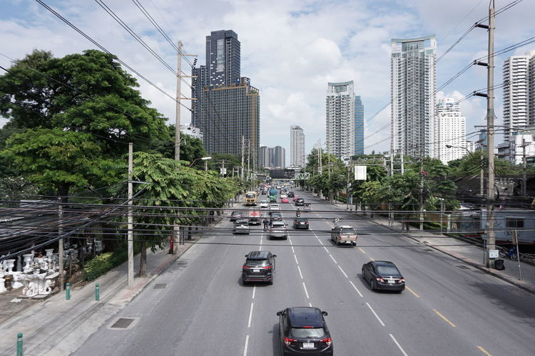 City Tree Urban Skyline Cityscape Skyscraper Road Car Land Vehicle Street Sky Highway Traffic Two Lane Highway Urban Road Multiple Lane Highway