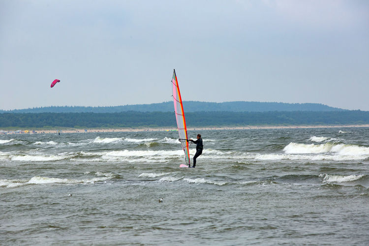 Baltic Sea Adventure Aquatic Sport Beauty In Nature Extreme Sports Freedom Horizon Over Water Kiteboarding Leisure Activity Lifestyles Men Motion Nature One Person Outdoors Real People Sea Skill  Sky Sport Surfing Water Waterfront Wave
