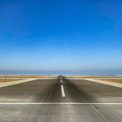 View of airport runway against clear sky
