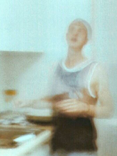 Blurred motion of woman sitting at home