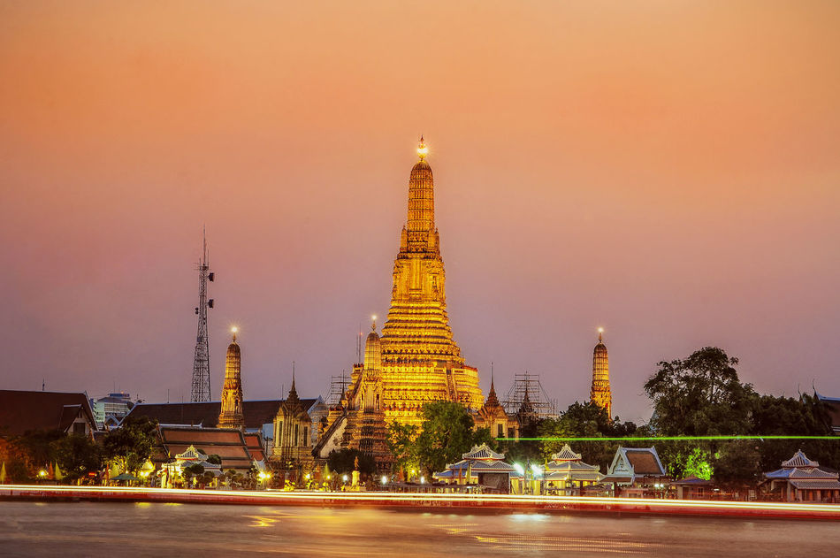 Temple of the Dawn, Bangkok Monastery Antiquities Antiquities In Thailand Architecture Belief Building Building Exterior Built Structure City Dusk History Illuminated Long Exposure Motion Nature Night Office Building Exterior Outdoors Place Of Worship Religion Sky Skyscraper Spirituality Tower Travel Destinations