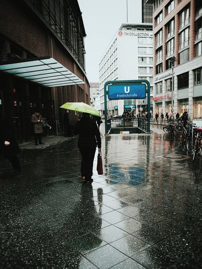 Under my umbrella... Architecture Reflection City Building Exterior Water Outdoors Built Structure Business Finance And Industry People Rainy Days Rain Wet Ground Umbrella Streetphotography Streetphotography Colors Welcome To Black
