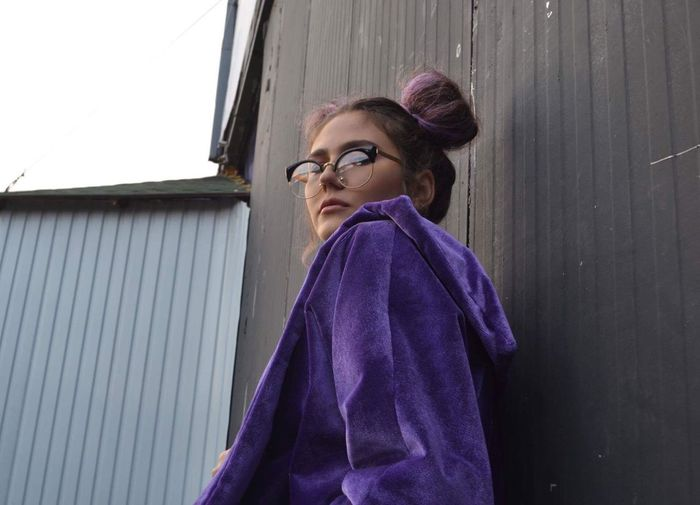 Glasses Real People Eyeglasses  One Person Standing Lifestyles Waist Up Built Structure Architecture Women Leisure Activity Young Adult Looking Away Building Exterior Wall - Building Feature Window Young Women Looking Purple Hairstyle Stories From The City