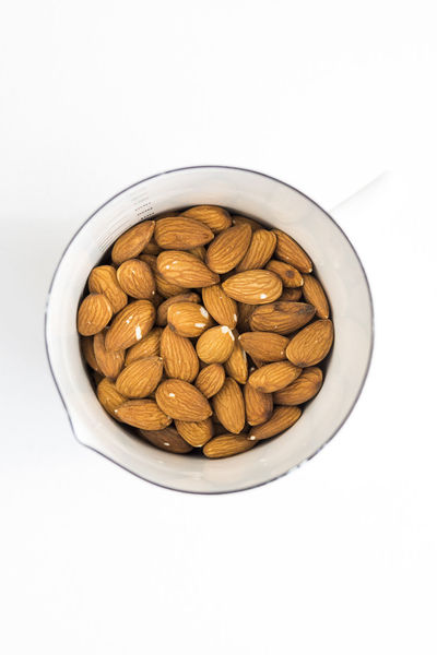 Abundance Almond Almonds Bowl Close-up Cut Out Food Freshness Indulgence Large Group Of Objects Me No People Nut Nuts Overhead View Raw Raw Food Ready-to-eat Roasted Coffee Bean Still Life Studio Shot Top Perspective Top Shot White Background