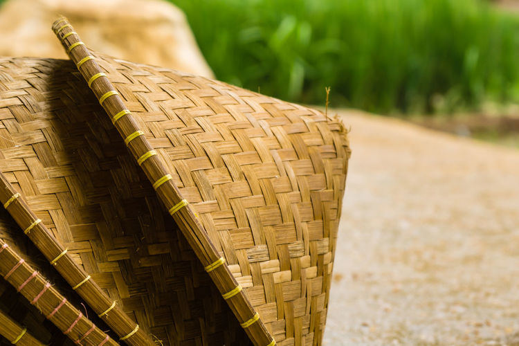 Close-up of wicker basket on field