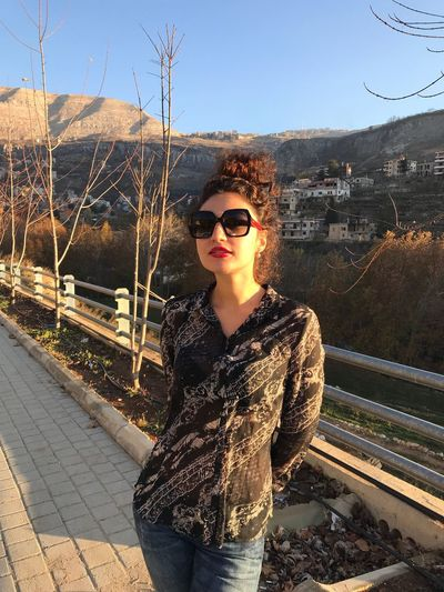 Mountains And Sky Mountains And Valleys Sunglasses Young Adult Outdoors Young Women Standing One Person Clear Sky Day Real People Lifestyles Beautiful Woman Portrait Tree Sky Nature People
