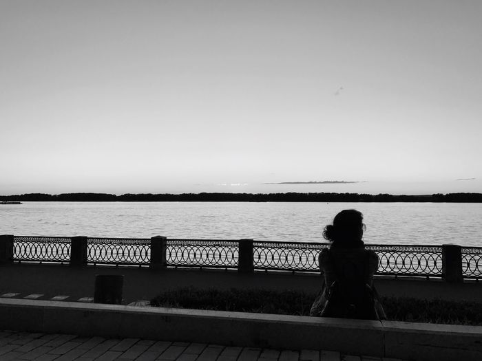 Railing Water Sea Clear Sky Women Rear View Silhouette Real People Standing Leisure Activity One Person Sunset Nature Outdoors Built Structure Scenics Lifestyles Sky Beauty In Nature Day Sunlight Sunset Silhouettes Sunset_collection Side View Clear Sky