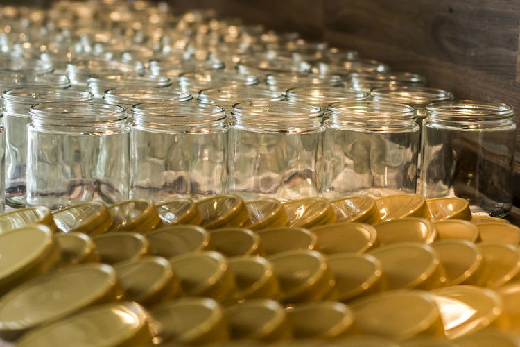 Close-up of jars and lids arranged on table