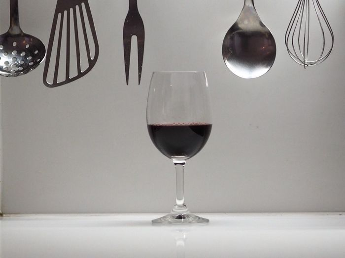 Wineglass with kitchen utensils