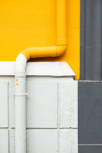 Minimalist Minimalist Architecture The Week on EyeEm Architecture Building Building Exterior Built Structure Close-up Connection Day Man Made Metal Minimal Minimalism No People Outdoors Pattern Pipe Pipe - Tube Pipeline Wall Wall - Building Feature Water Pipe White Color Yellow