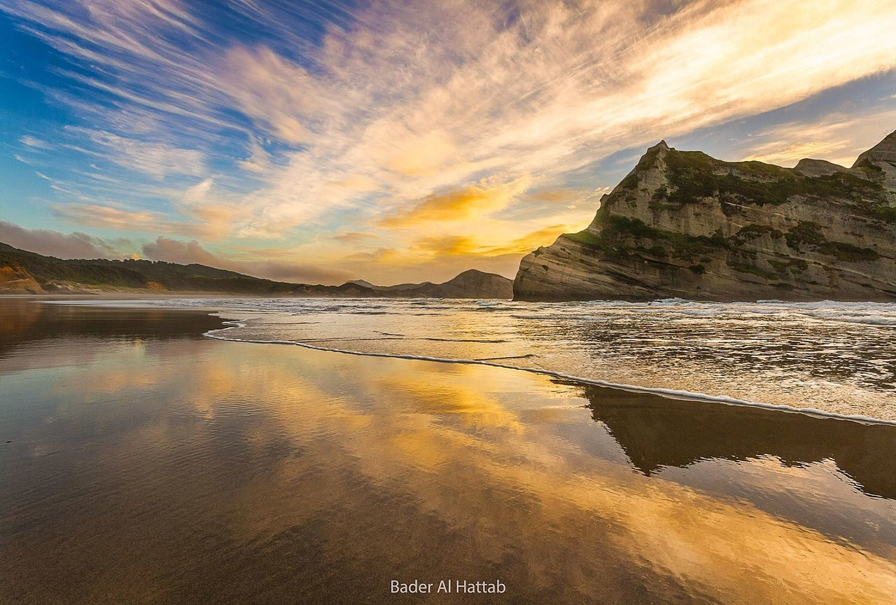 sea, sunset, scenics, sky, nature, water, beach, beauty in nature, rock - object, tranquility, tranquil scene, cloud - sky, no people, outdoors, horizon over water, mountain, day