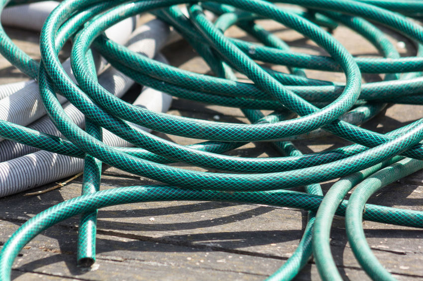 Abstract Photography Backyard Curve Green Green Color Abstract Abstraction Abstractions Backgrounds Cable Close-up Coil Connection Curved  Day Green Color Hose Hosepipe Hoses No People Outdoors Still Life