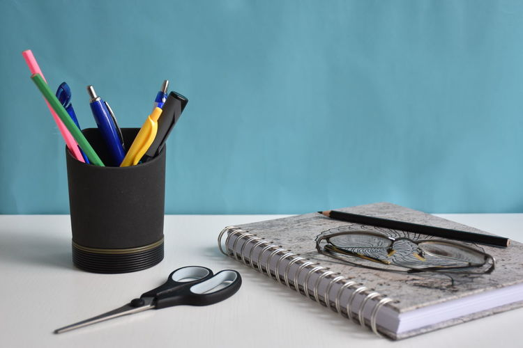 Pencil Table Indoors  Writing Instrument No People Desk Organizer Still Life Scissors Pen Large Group Of Objects Close-up Office Supply Multi Colored Colored Pencil Variation Office Choice Education Glasses Notebook Blue Desk White