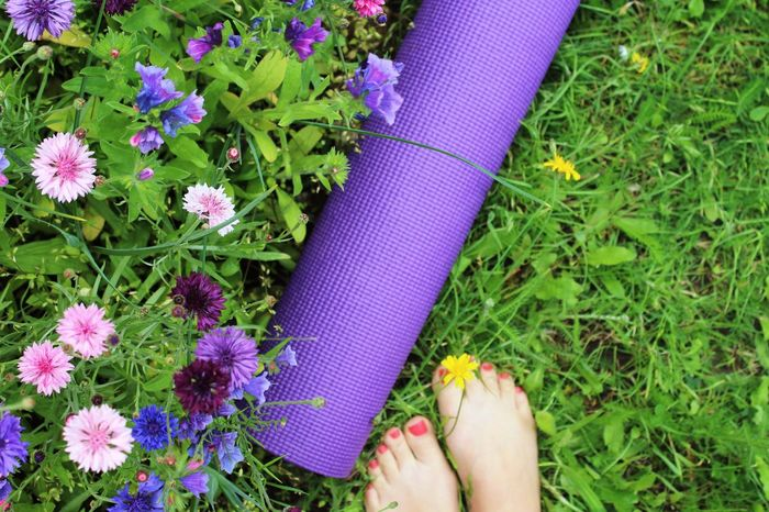 Reconnecting with nature. Yoga Yoga Practice Yoga Girl Yoga Feet Yoga Mat Nature Flowers Flowers, Nature And Beauty Grass Green Color Purple Summer Views Yoga In Nature Feet Foot Garden Yoga Lover Yoga Time Creative Photography Creative Shots Unrecognizable Person
