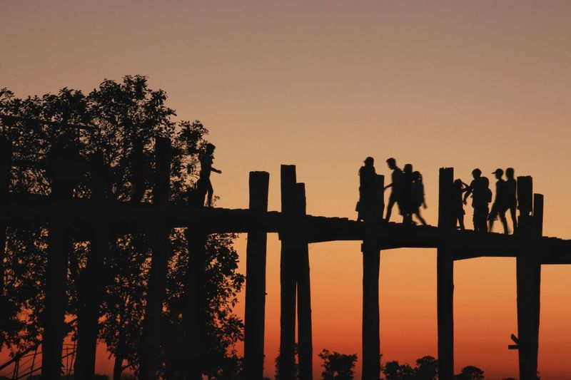 Evening at U Bein bridge in Mandalay, Myanmar. Wonderful Amazing people and places Lifestyles Asianstyle Landmark Landscape_photography Sunset Silhouettes Dusk Rural Scenes A Shot Moment In The Time Impression Woodden Bridge Hiking Trail Walking Horizon Agricultural Field Beauty In Nature Scenery Tree Sunset Standing Silhouette Sky Landscape