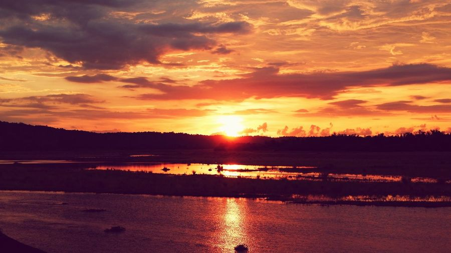 Sunset view at Rivermount Hotel, Ilocos Norte, Philippines Relaxing Water Sunset Lake Low Tide Sunlight Reflection Silhouette Tree Swamp Reflection Lake Dramatic Sky Seascape Atmospheric Mood Romantic Sky