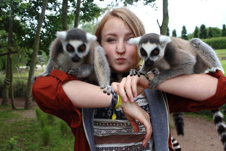 Portrait Of Woman With Lemurs