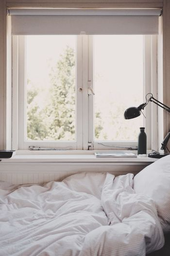 Window Bed Indoors  Bedroom Domestic Room No People Furniture Lifestyles Home Interior Day Domestic Life White Color Comfortable Cozy Simplicity Nature Relaxation Sunlight