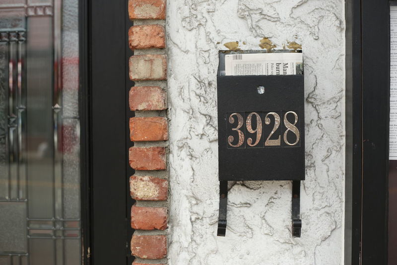 Mailbox on a stucco and brick building exterior. Home Horizontal Architecture Building Exterior Built Structure Close-up Communication Concept Conceptual Day Door House No People Outdoors Public Mailbox