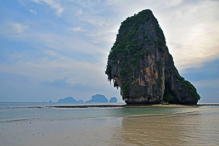Scenic view of rock in sea at railay beach