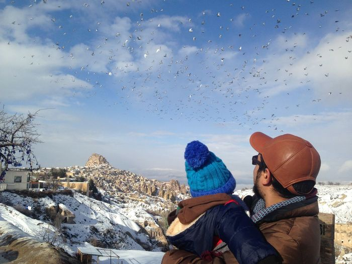 Bonding time of a father and his son Babyboy Cappadocia Cappadocia/Turkey Travel Turkey Türkiye Beauty In Nature Bonding Flying Bird Leisure Activity Men Mountain Nature Outdoors Pigeon Valley Rear View Sky Son And Dad Son And Daddy Togetherness Two People Vacations Warm Clothing Winter