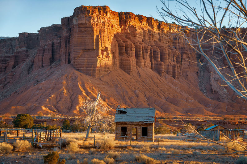Sunrise at Capitol Reef, Utah. Old farmhouse seen just north of Torrey, Utah at first light. Capitol Reef Ranch Torrey Pines Utah Utah Scenery Abandoned Arid Climate Countryside Day Eroded Formation Geology Land Landscape Mountain Nature No People Outdoors Rock Rock - Object Rock Formation Scenics - Nature Tranquil Scene Travel Travel Destinations