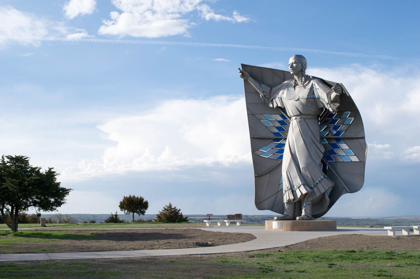 Dignity Native American Indian South Dakota Statue Art And Craft Chamberlain Cloud - Sky Day Environment Human Representation Land Landscape Low Angle View Male Likeness Native American Nature No People Outdoors Plant Representation Road Sculpture Sky Sunlight Transportation Tree