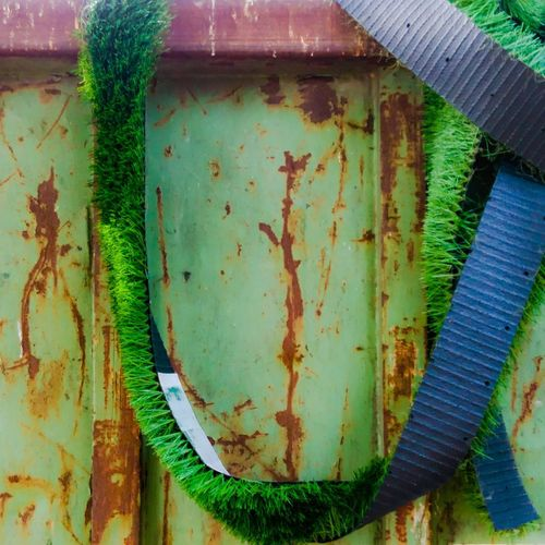 The Week On EyeEm Green Color Rusty Abandoned Run-down Weathered No People Day Outdoors Close-up Plastic Plastic Grass Garbage