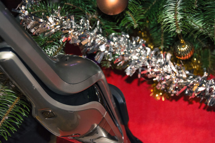 Close-up of a vacuum cleaner under a Christmas tree. I unfortunately had to remove the dominant logo of the manufacturer to meet the server conditions ... Christmas Christmas Decoration Christmas Tree Close-up No People Tree Vacuum Cleaner Vacuum Cleaner Detail