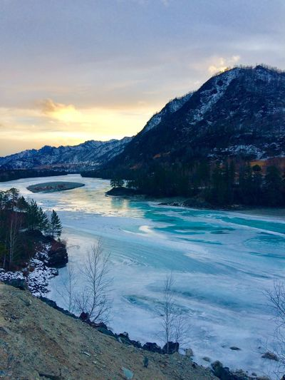 The Katun River, Altay, Russia Tiffany Coloured River Russian Nature Russia Altay Nature Beauty In Nature Mountain Scenics Tranquil Scene Snow Water