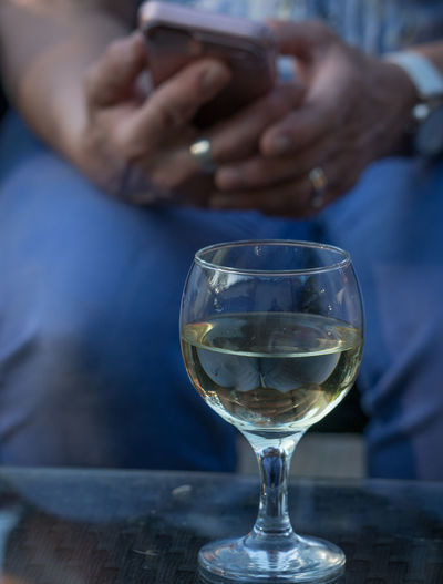 Ring tones Alcohol Units Safe Drinking Mobile Phone Alcohol Close-up Drink Focus On Foreground Food And Drink Freshness Glass Hand Holding Human Hand Midsection One Person Real People Refreshment Rings Table Technology Transparent Wine Wineglass