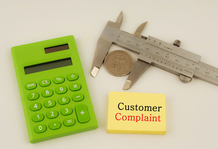 Quality concept Quality Time Close-up Communication Complaint Customer  Day Defect Defense Engine Financial Indoors  Issues No People Number Profit Ruler Still Life Table Text White Background