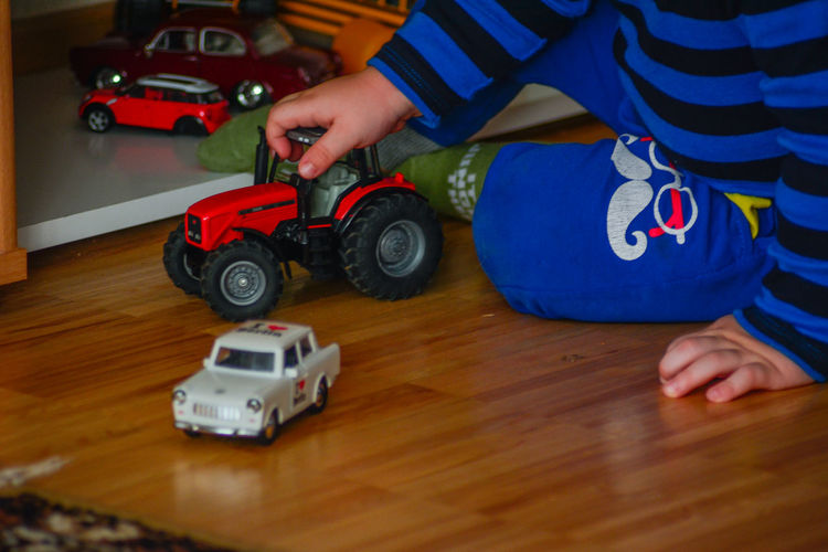 One Person Leisure Activity Baby Childhood Low Section Real People Day Transportation Toy Car Toy Racecar Car Playing Auto Racing Road Close-up Focus On Foreground Lifestyles Indoors