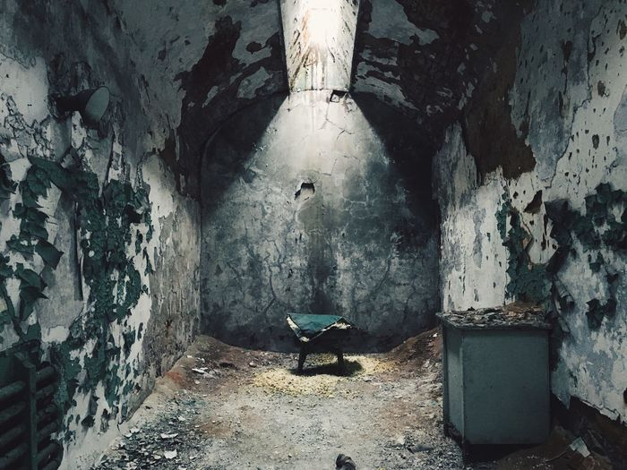 Interior Of Weathered Cell In Abandoned Prison