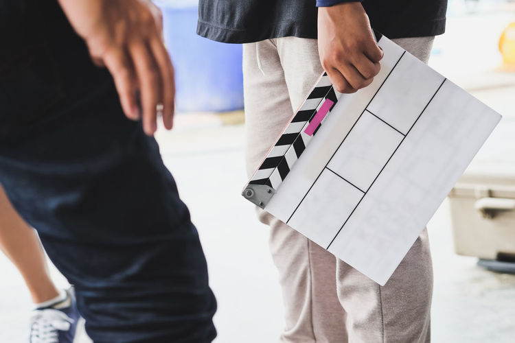 Film Slate, close up image of film production crew holding Film Slate on set Behind The Scenes Filming Studio Behindthescenes Broadcast Broadcasting Clapper Board Clapperboard Film Crew Film Industry Film Location Film Production Film Slate Photography Themes Studio Photography Studio Shot