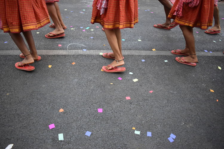 Low section of women dancing on street