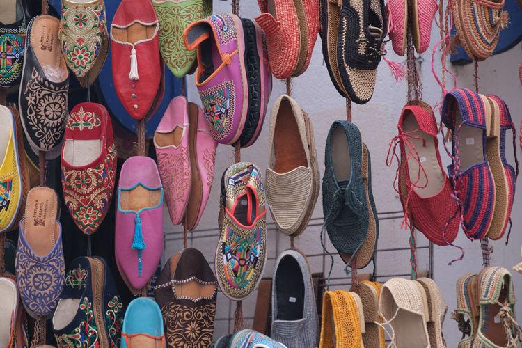Full frame shot of shoes for sale at market