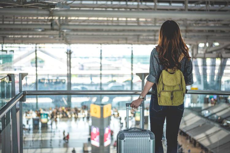 Woman Walking At Airport