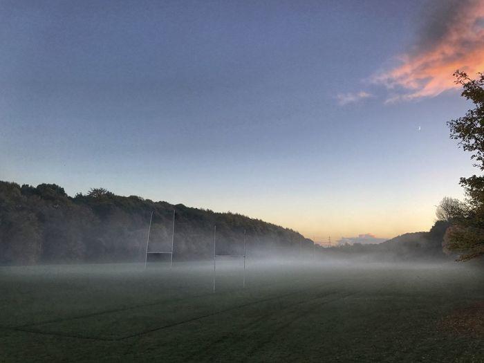 Misty landscape against blue sky