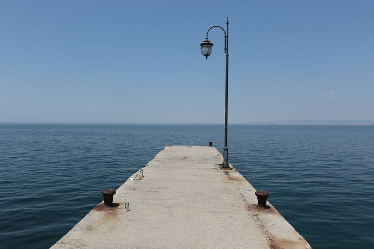 A pier in Perea, near the city of Thessaloniki, Greece. Beauty In Nature Clear Sky Concrete Day Horizon Over Water Lamps Light Pole Nature No People Outdoors People Pier Scenics Sea Sky Street Light Tranquil Scene Tranquility Water