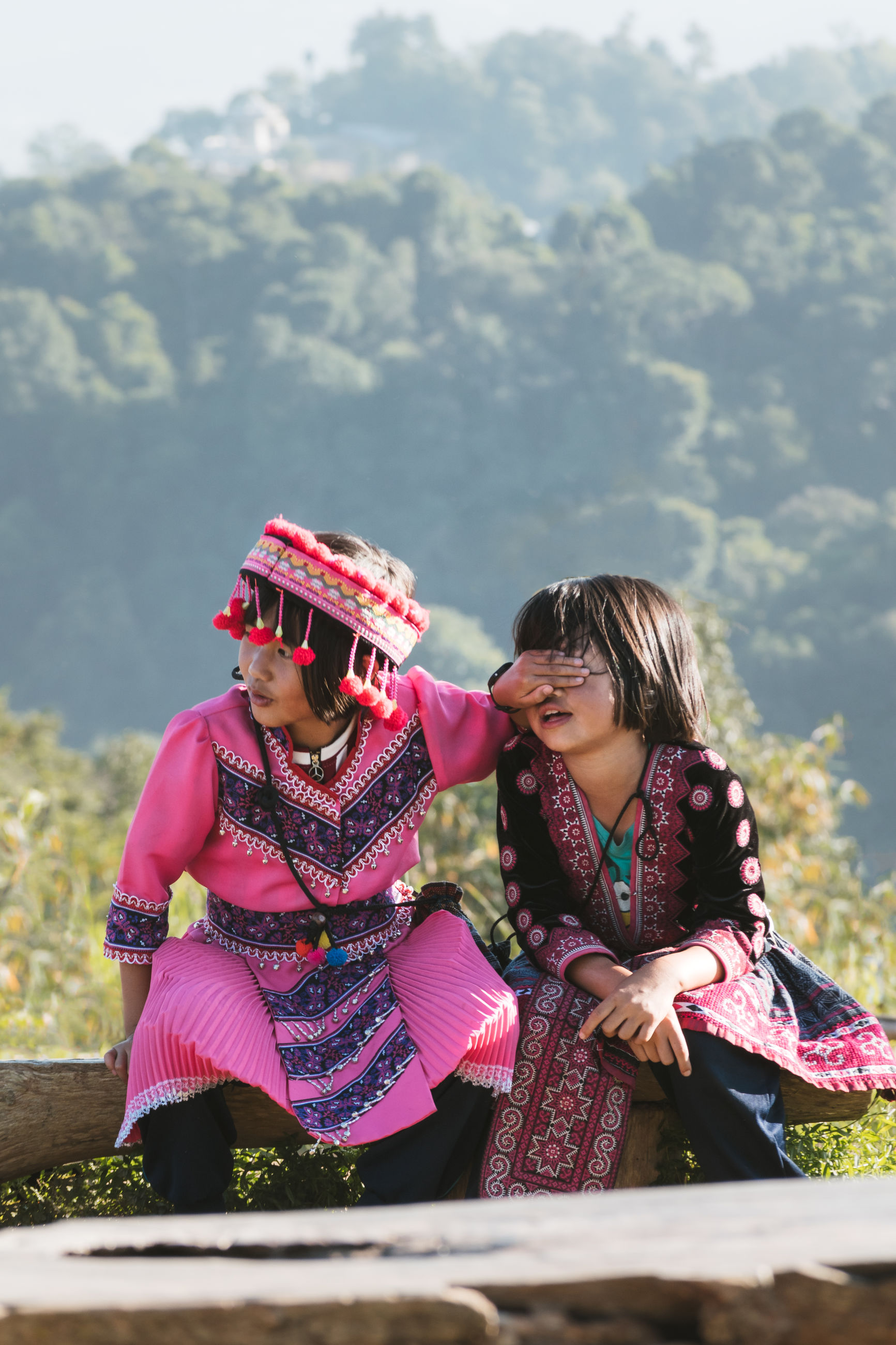women, real people, leisure activity, two people, togetherness, lifestyles, females, mountain, adult, sitting, girls, people, bonding, nature, clothing, traditional clothing, day, child, plant, childhood, outdoors, sister, daughter