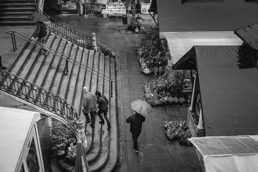 Up the stairs Architecture Building Exterior Built Structure Casual Clothing City City Life Day Full Length High Angle View Lifestyles Market Marketplace Men Mercado Do Bolhão Monochrome Photography Old Outdoors Person Rain Rainy Days Stairs Stairway Walking