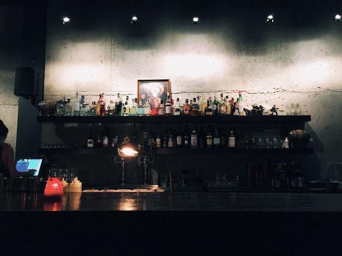 Illuminated bottles on table in restaurant